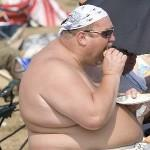 Obese man eating fast foods